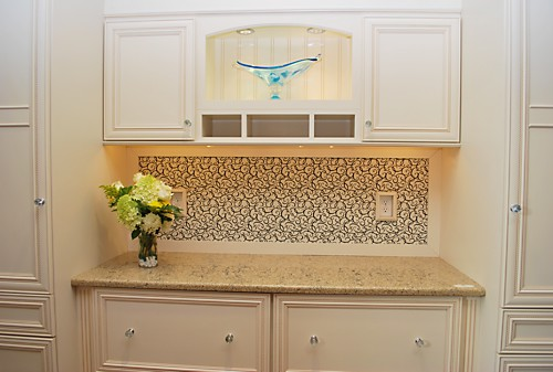 Designer Lisa Zompa's desk at the Kitchen Views showroom in Warwick, Rhode Island, featuring white Omega Dynasty cabinets