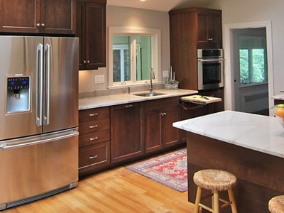 Stained Cabinets with Light Walls and Countertop