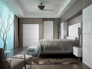 Stylish bedroom showing multiple cabinets in contrasting colors