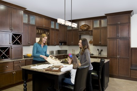 Amy Mood of Kitchen Views works with a client and her daughter on a kitchen remodeling project