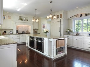 spacious kitchen with low ovens and storage options