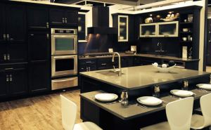 Omega display at 2014 KBIS of CALDERA cabinetry with some flip-up doors.