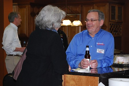 Mike McDole speaking to a guest at the EM NARI Networking Event