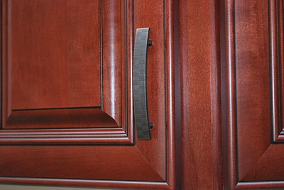 This cabinet pull with curved shape and textured surface works well with traditional or contemporary cabinetry.