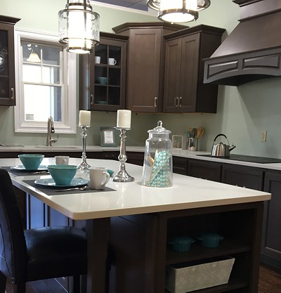Homecrest dark gray cabinetry and white counters
