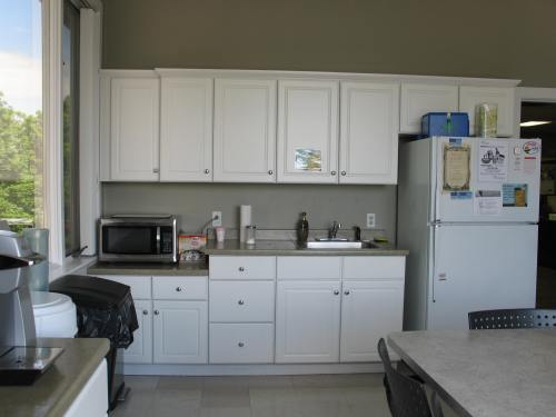 BEFORE - office break room with white Thermofoil cabinetry