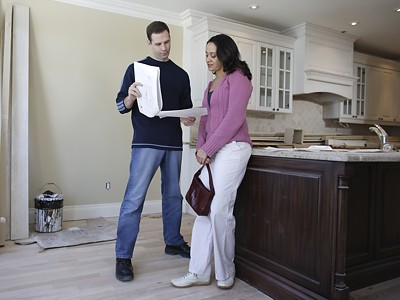 remodeling-contractor-meeting-with-homeowner-in-kitchen
