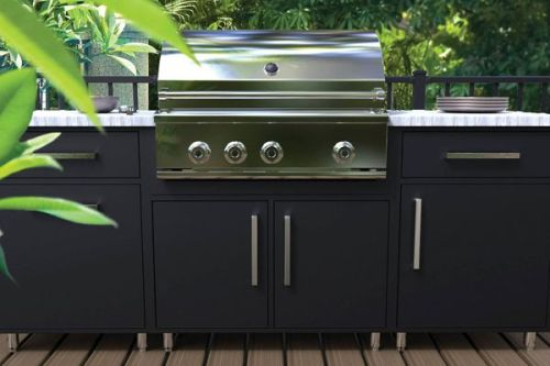 Wolf Endurance black outdoor cabinetry with built-in gas grill on deck