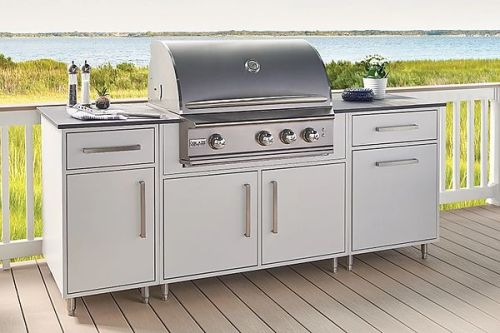 Wolf Endurance outdoor cabinetry with built-in gas grill on a deck