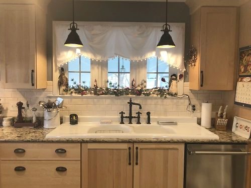 Country kitchen sink area in North Attleboro home designed by Nicole Amaral